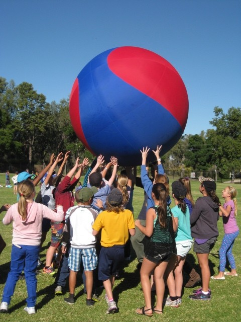 Students playing with a giant ball